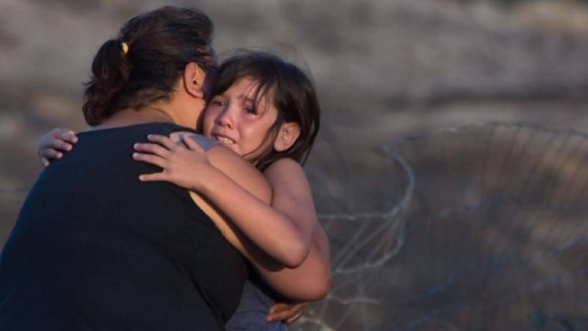 Angie Thorne comforts her 8-year-old granddaughter, surveying what is left of their fire-ravaged home on Ashcroft First Nation, near Ashcroft, B.C., late Sunday.