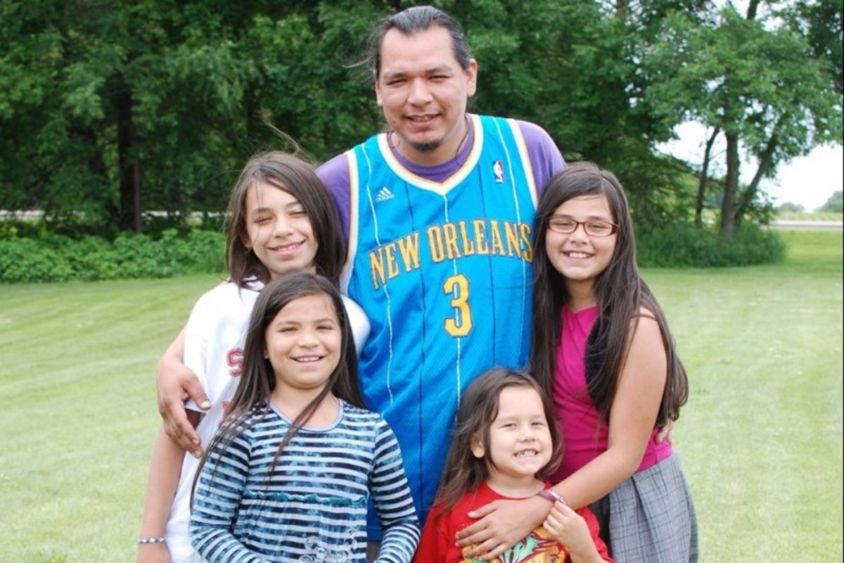 Marcus L. Roberts, center, with his children. Roberts was shot and killed during a Christmas party in December 2015.