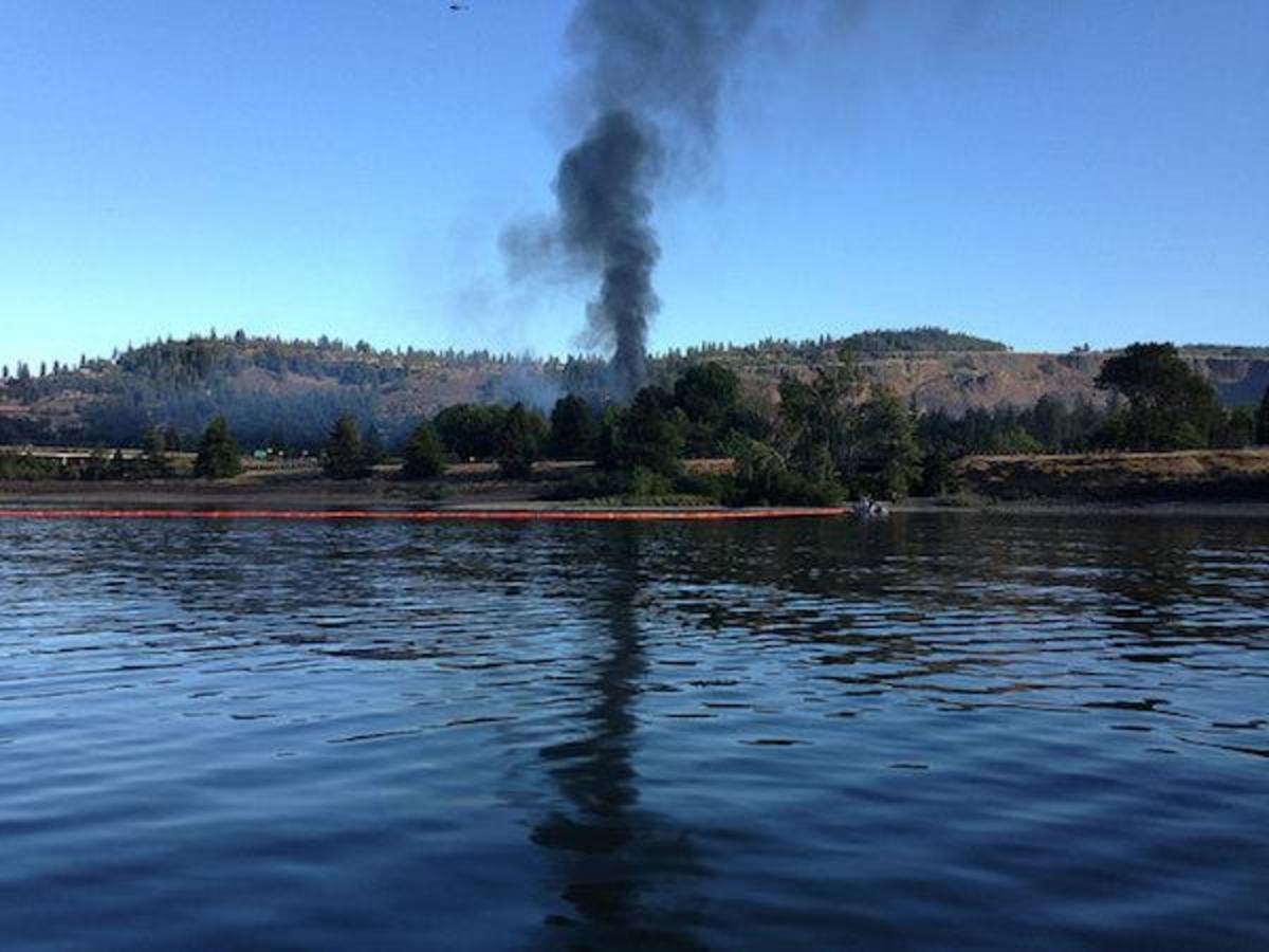 Sixteen cars of a Union Pacific train carrying highly volatile Bakken crude derailed over the weekend, and four caught fire, leaking oil into the Columbia River and prompting evacuations.