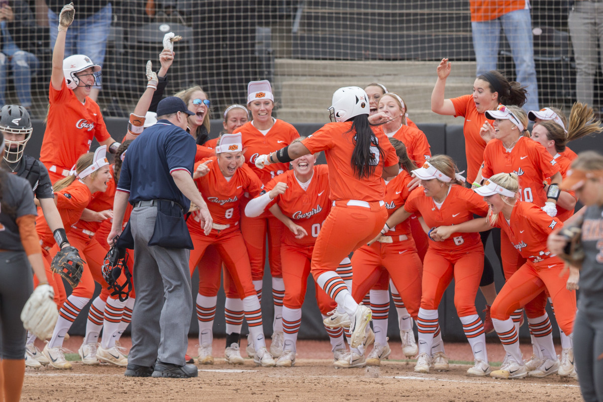 Haylan Galvan comes in for a homerun at the Oklahoma State Cowgirls vs Texas Longhorns Softball Game, Sunday, March 26, 2017, Cowgirl Softball Complex, Stillwater, OK. Courtesy Bruce Waterfield/OSU Athletics
