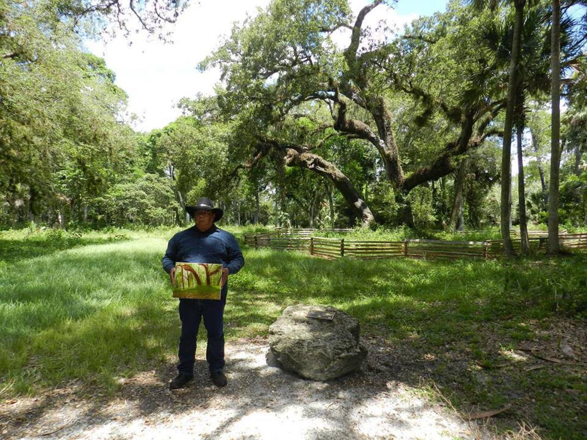 Elgin Jumper, a member of the Seminole Tribe, visited the Tree of Tears and painted it in 2016.