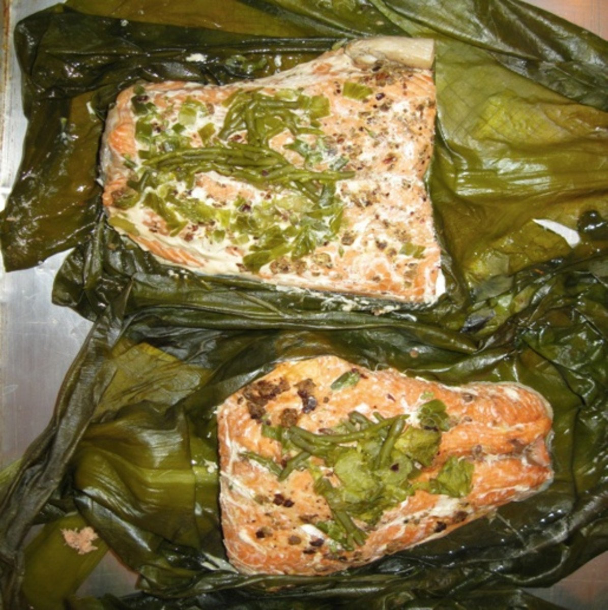 Salmon baked with wild celery, onion and skunk cabbage