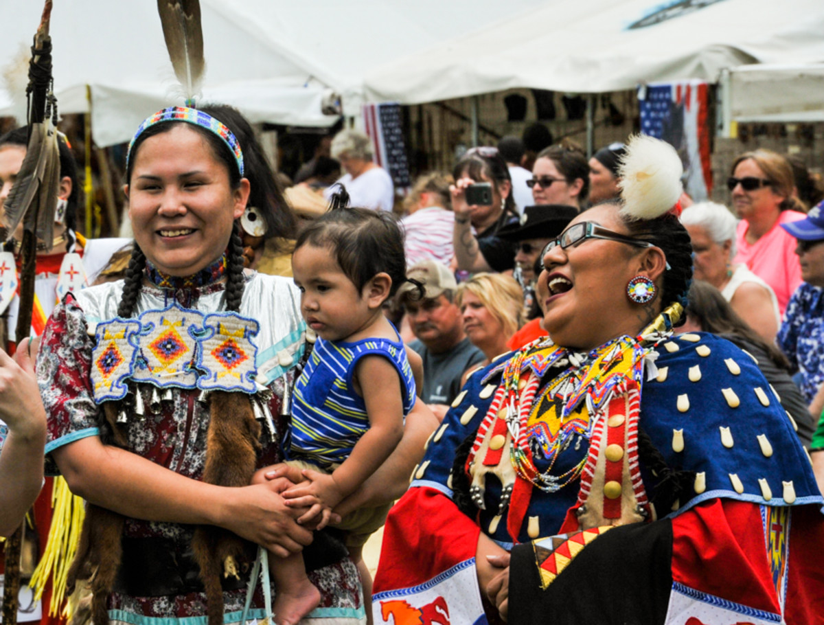 Mothers Taryn Walking Eagle-Mesteth and Amanda Tortalita participating in the 28th Mother's day Pow Wow in Canton, GA. Amy Morris