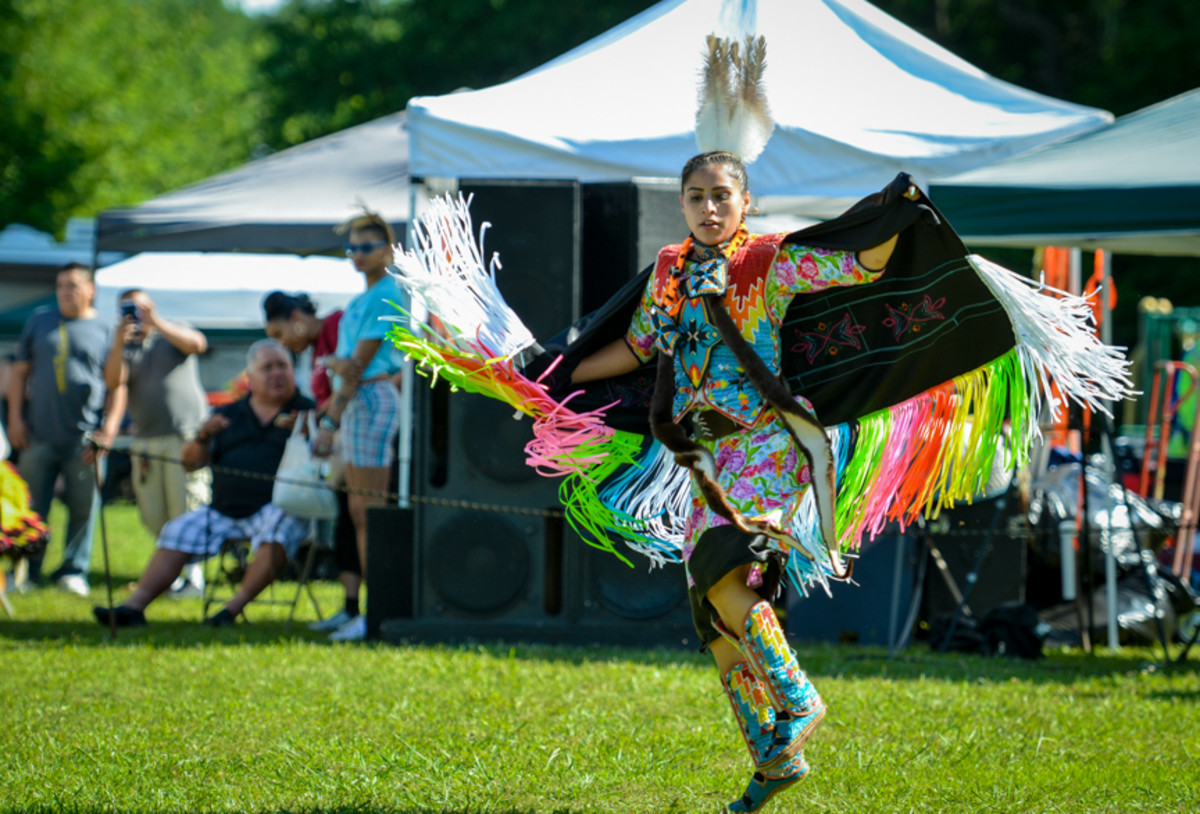 Fancy shawl dancer, Wahlalah Brown of the Eastern Band of Cherokee at the Mother's Day pow wow in Canton, GA. Amy Morris