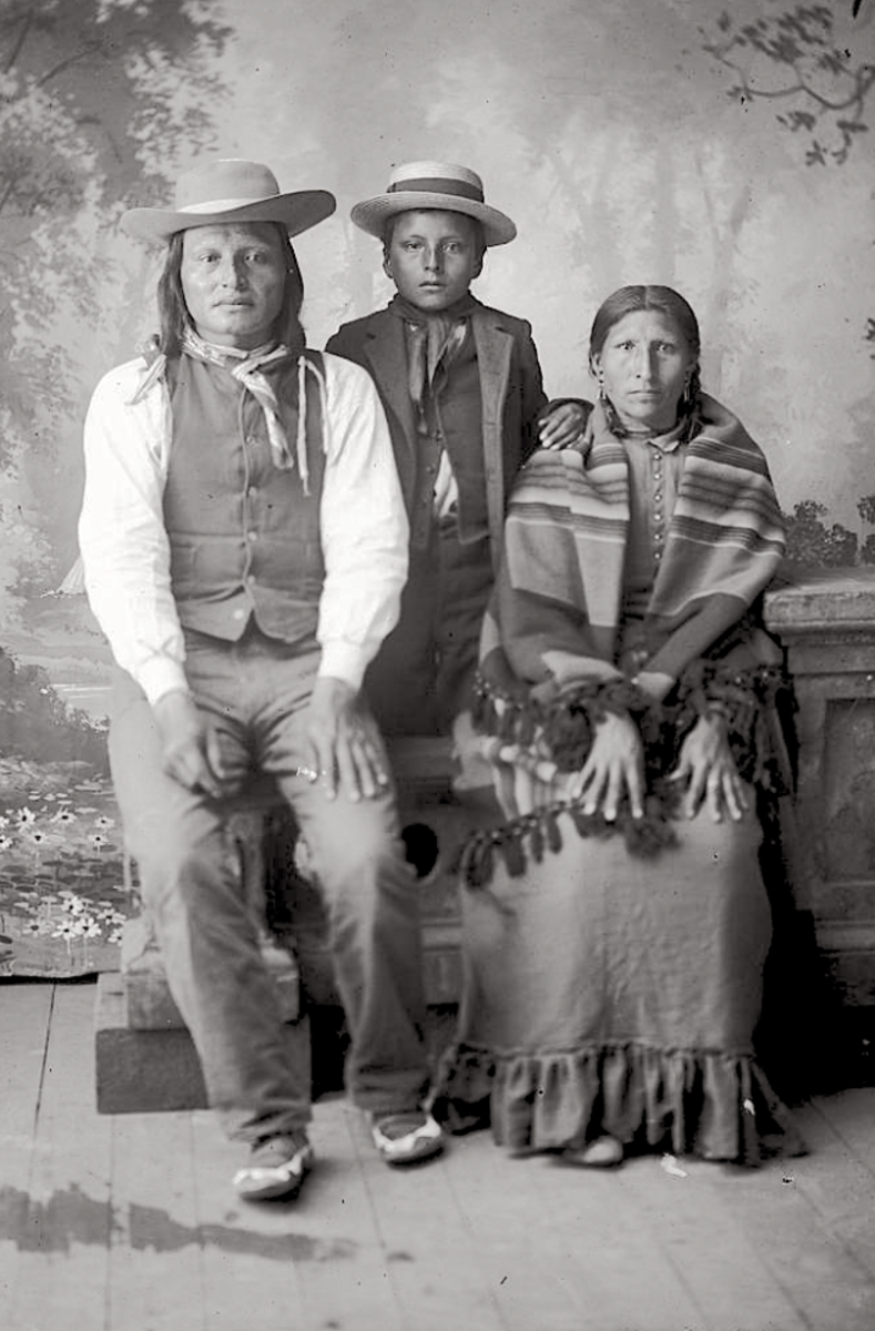 George Flying By, his wife, Hail Heart, and son, First To Kill. Hunkpapa Lakota. 1880s.