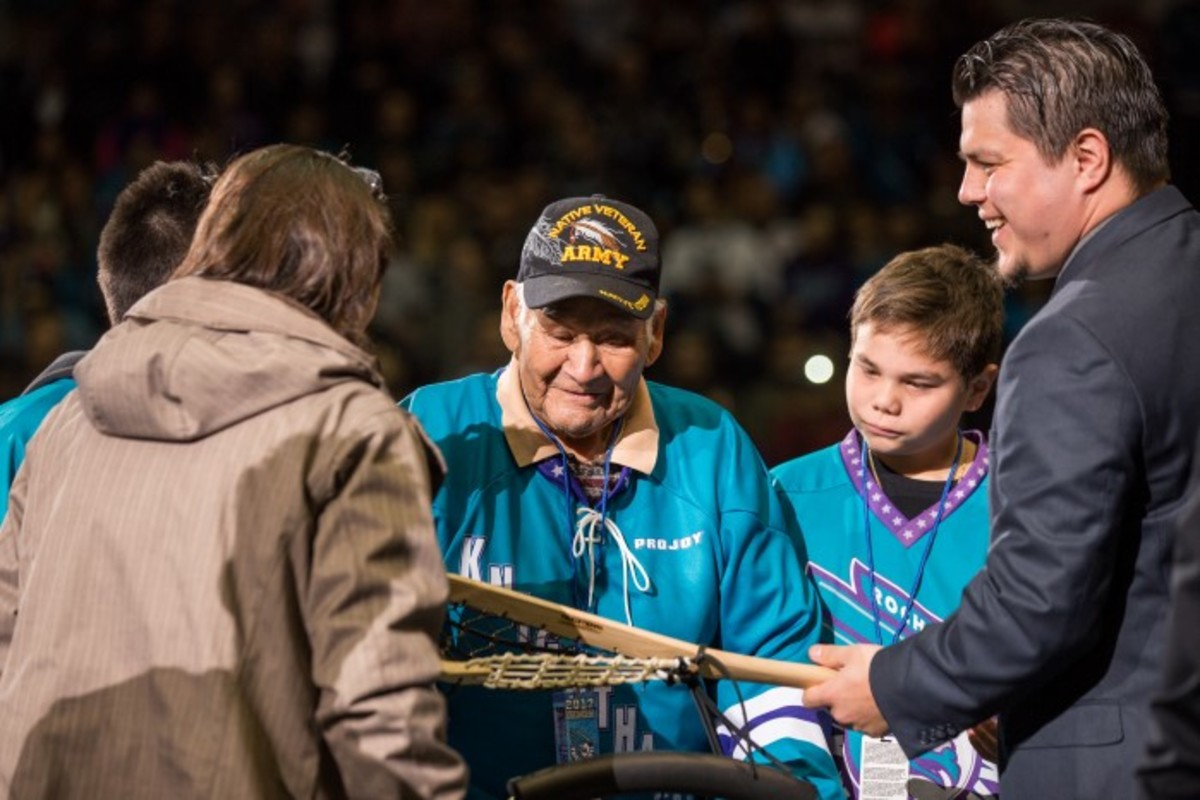 Levi Oakes was presented with a traditional lacrosse stick in honor of his Iroquoian Mohawk heritage. Photo Alex Hamer
