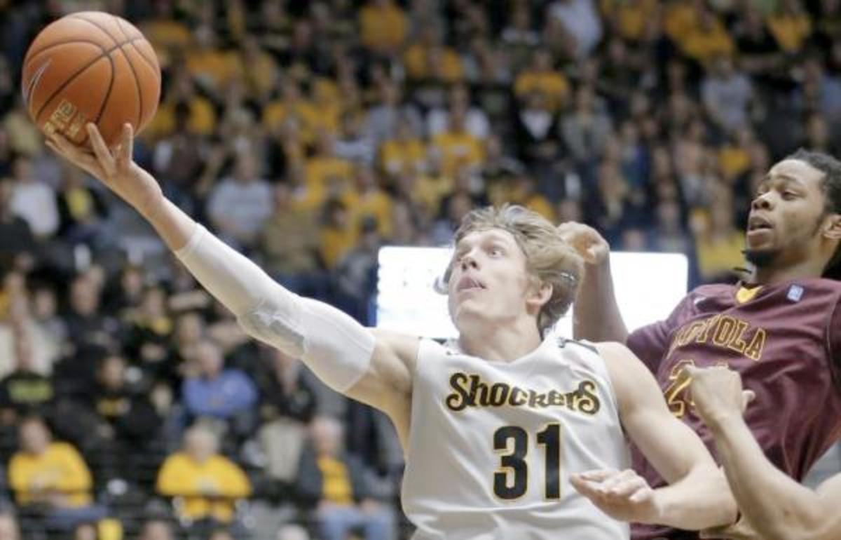 Ron Baker of Scott City, Kansas, has been selected as one of 15 finalists for the most prestigious award in Ccollege basketball. AP Photo/The Wichita Eagle, Travis Heying