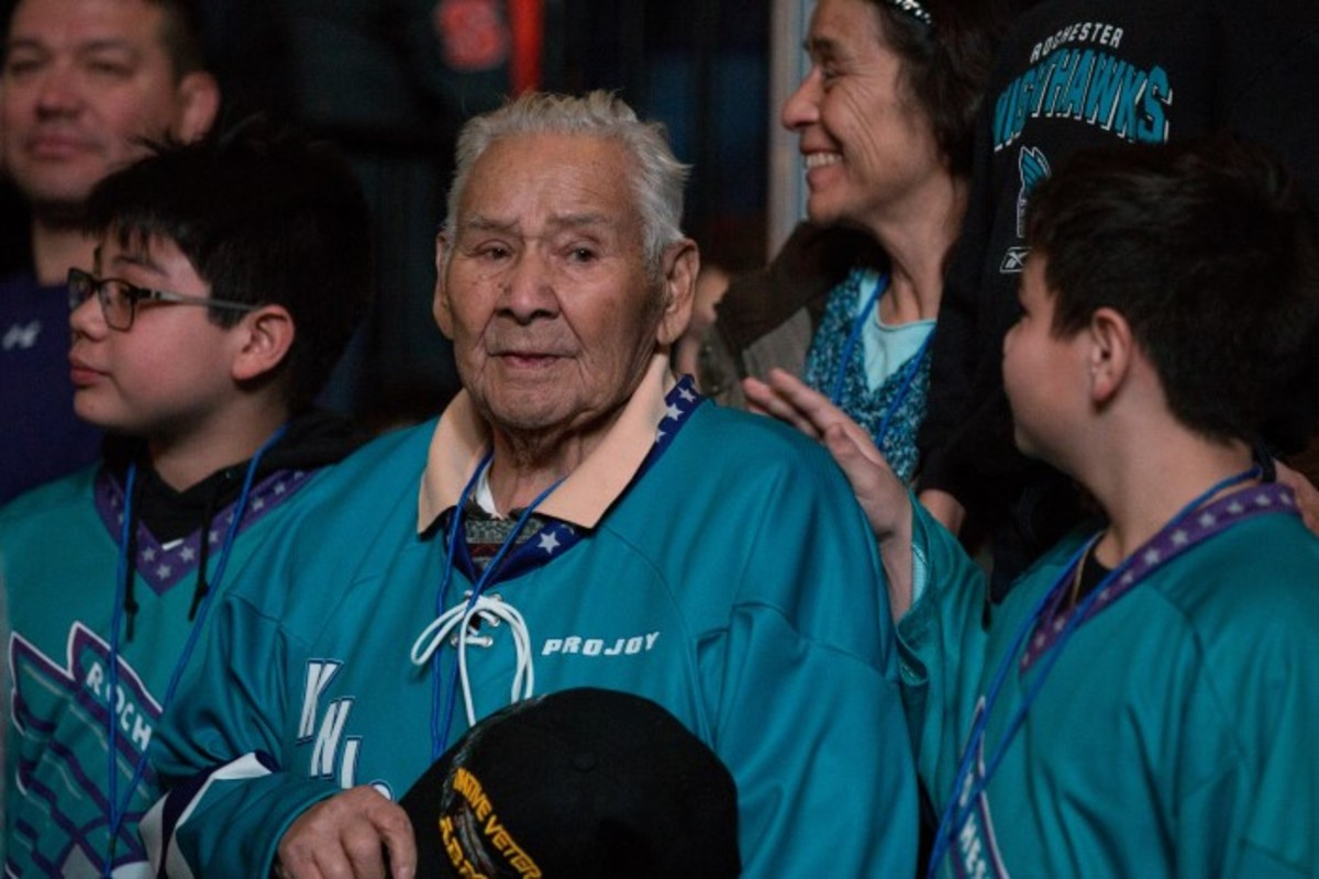 Levi Oakes, a World War II Mohawk code talker awarded a Silver Star, places his veteran's cap over his heart during the National Anthem. Photo Alex Hamer