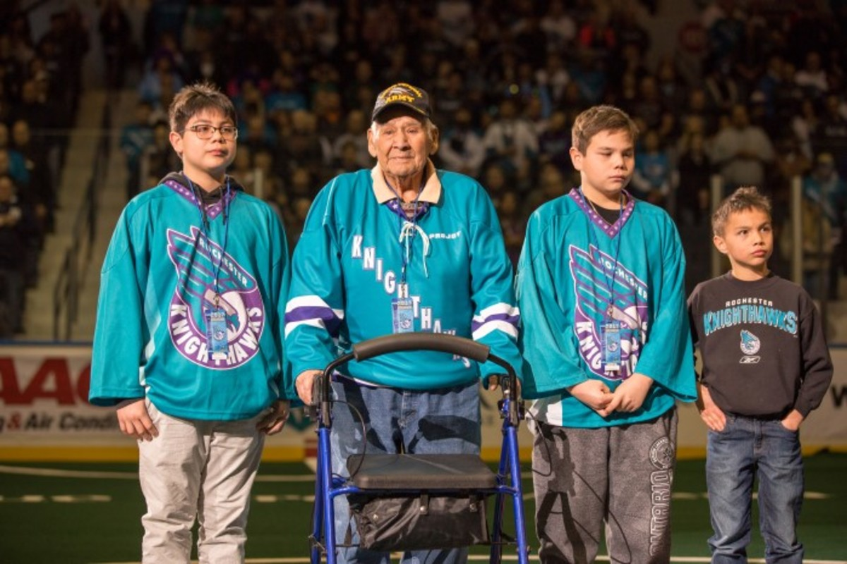 Levi Oakes stands at center field with his great grandchildren (left to right) Warren, (Levi Oakes) Ryan and Ronin Oakes. Photo Alex Hamer