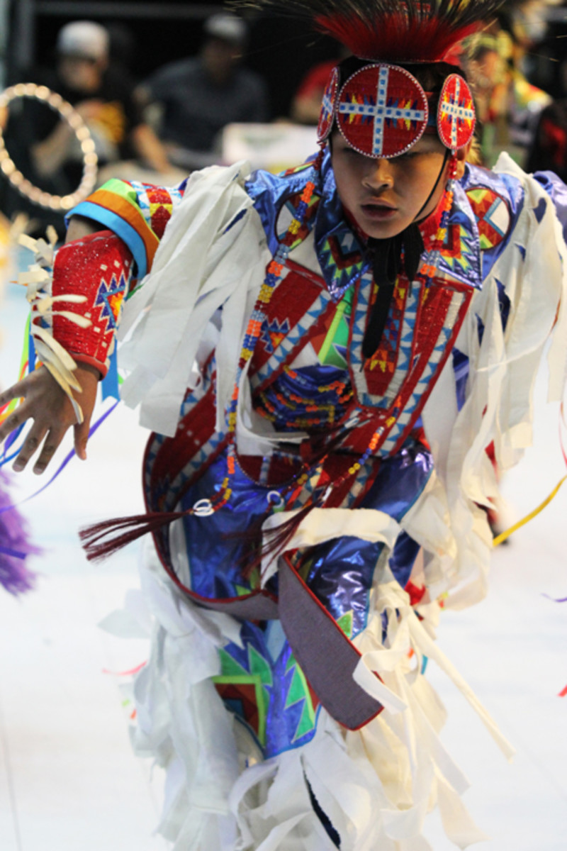 A young grass dancer shows off his moves during the Saturday afternoon contest. Cliff Matias