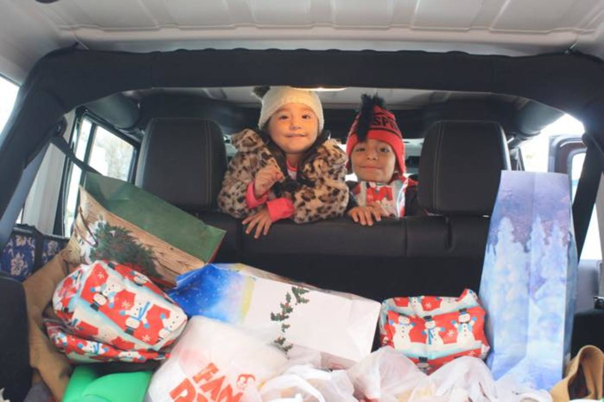 Native children pose with presents