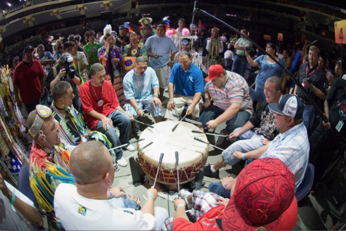 A drum group sings at a pow wow.