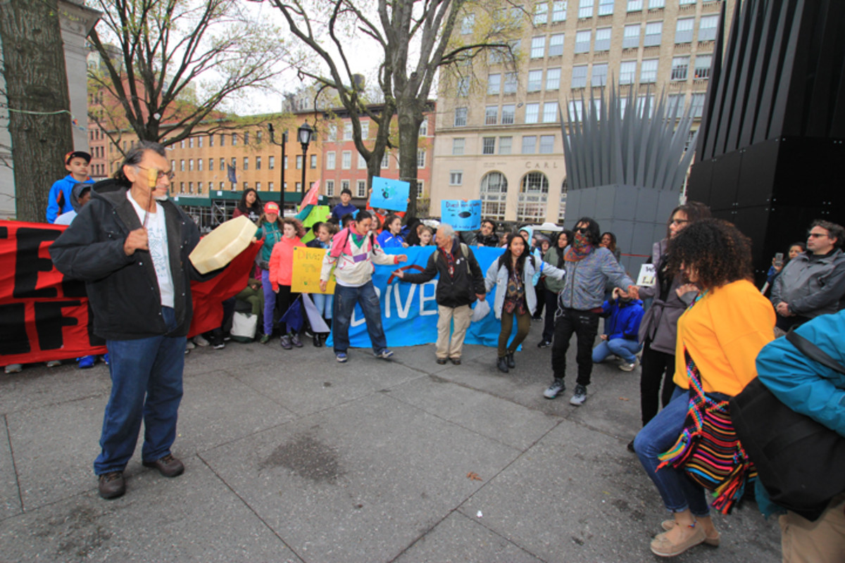 Protesters joined hands to sing and dance in front of the Cooper Union building outside the Citibank annual meeting.