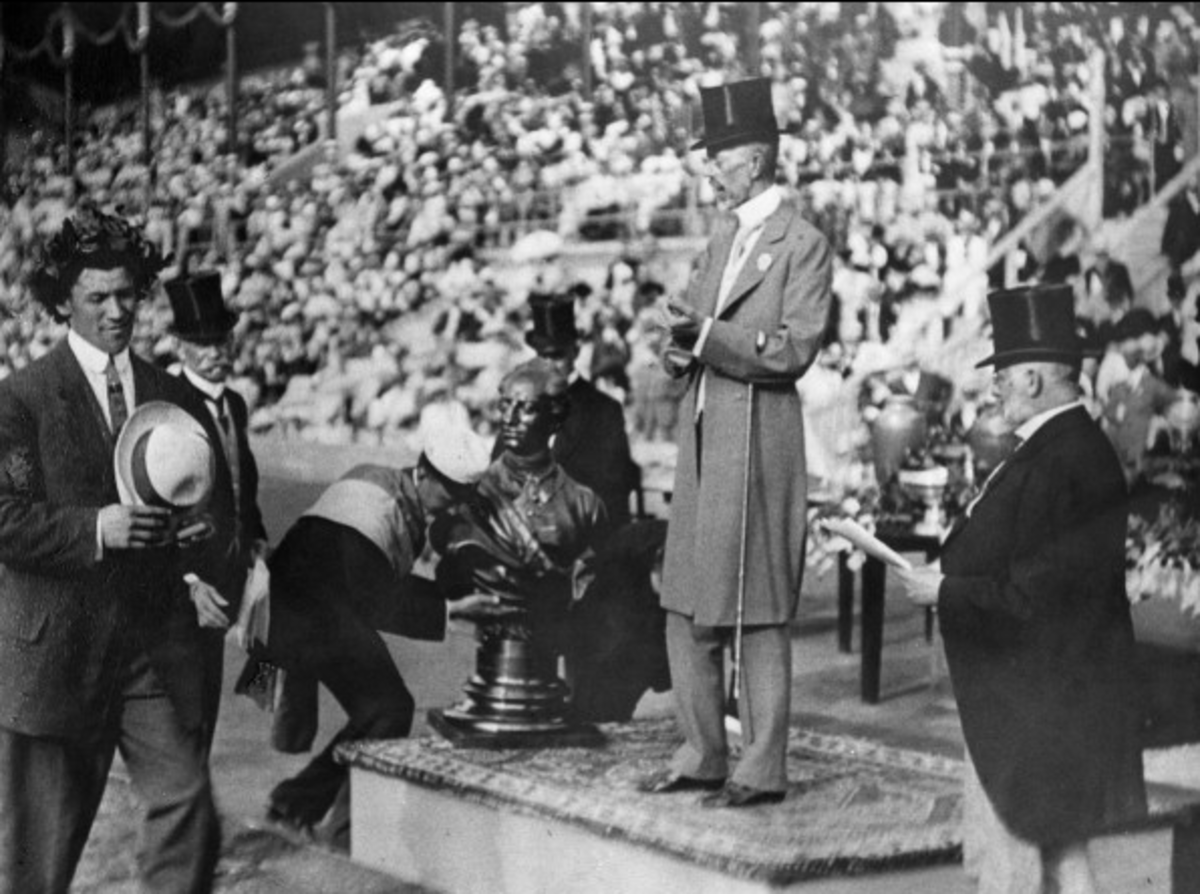 Jim Thorpe, Sac and Fox, receives his Olympic laurel crown from Sweden's King Gustav V at the 1912 Olympics in Stockholm, Sweden. (Photo courtesy of Carlisle Indian School History, Cumberland County Historical Society)