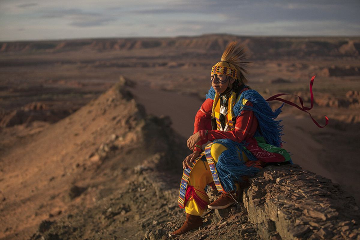 Grass dancer William Saganitso atop The Spine near the Tuba City outskirts.