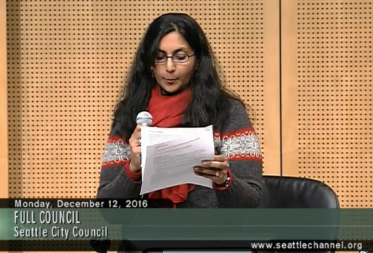 Seattle City Council Member Kshama Sawant reads a prepared statement as she introduces Council Bill 118883 to the council. The bill stops the city from continuing its business relationship with Wells Fargo, which currently manages the city's $3 billion operating account.