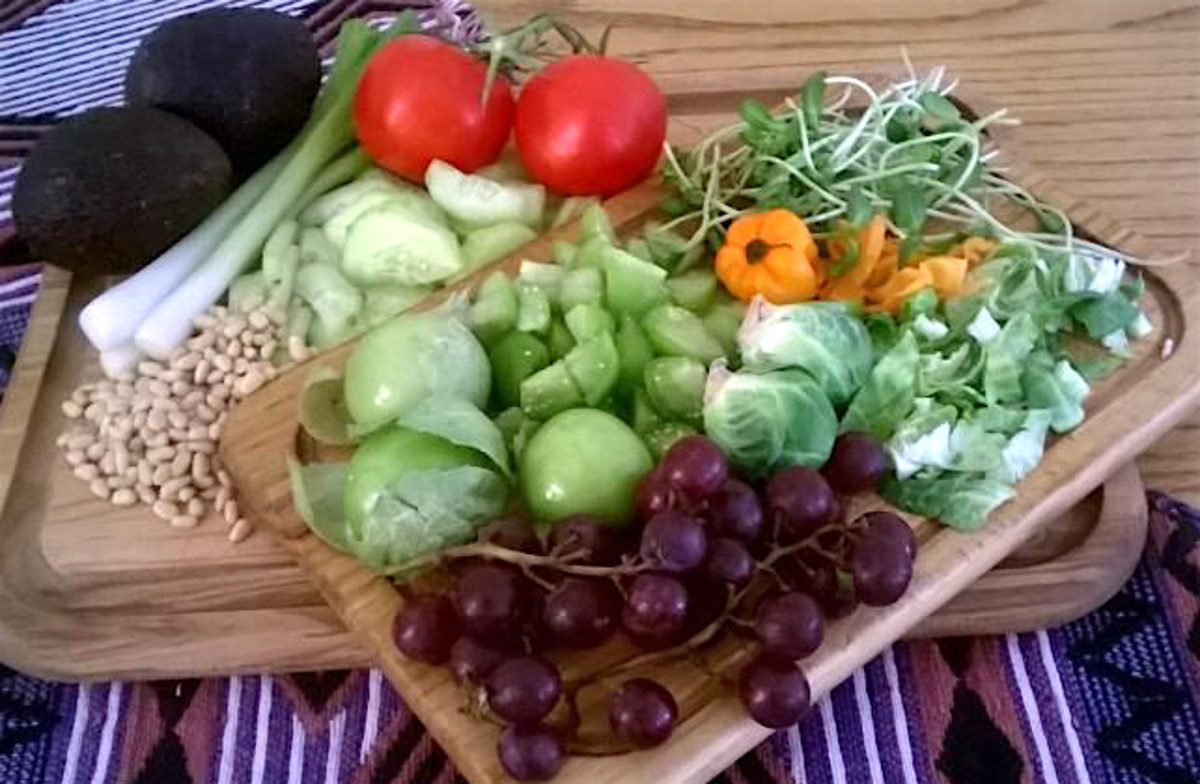 Garnishes for these recipes include avocado, green onions, cucumber, tomatoes, pine nuts, tomatillos, sunflower sprouts, habanero peppers, Brussels sprout leaves, and red grapes.