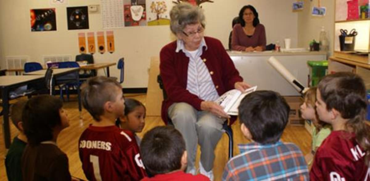 Cherokee elder Wynema Smith reading to students at Cherokee Language Immersion School in Tahlequah, Oklahoma. She is the narrator and author of the first audio books being put recorded by the Cherokee Nation Foundation and Cherokee Media Ltd.