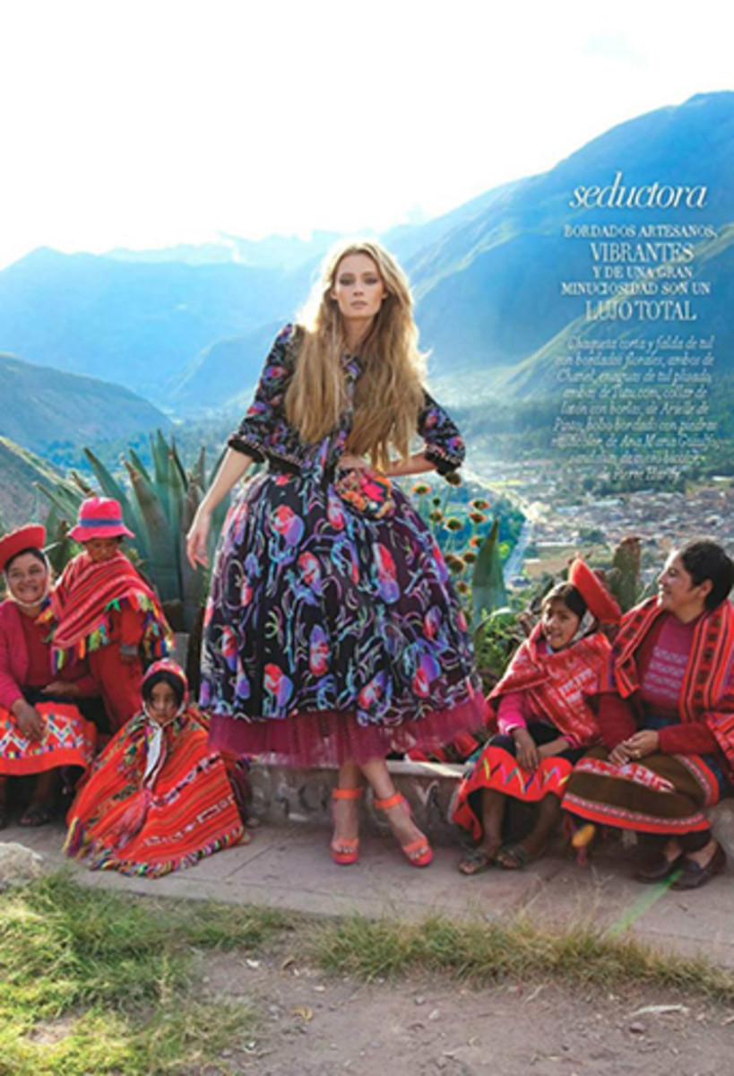 Indigenous, For Vogue Latin America. model Tiiu Kuik stands with arm akimbo surrounded by indigenous people from Peru.