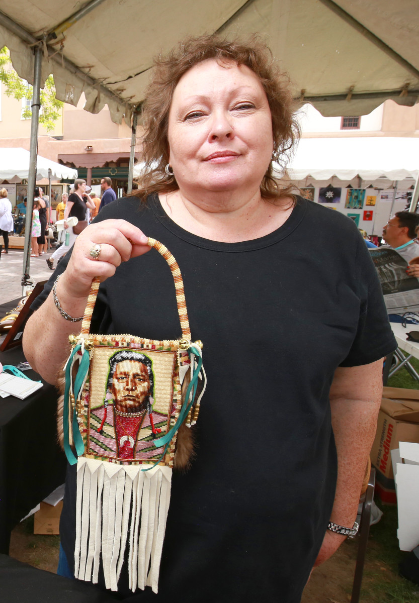Renowned beader, Jackie Beard, Blackfeet from Browning, Montana showed a beaded portrait bag portraying a family ancestor. Beard says the beadwork portraiture connects her to family and culture.