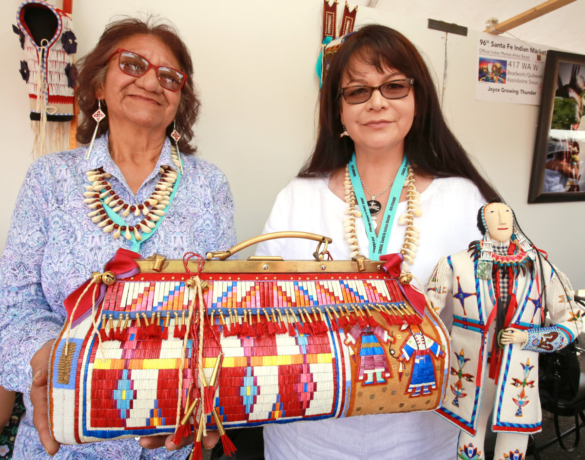 """Joyce Growing Thunder and Juanita Growing Thunder, Sioux mother and daughter, worked together on their """"doctor's bag"""" from Switzerland."""