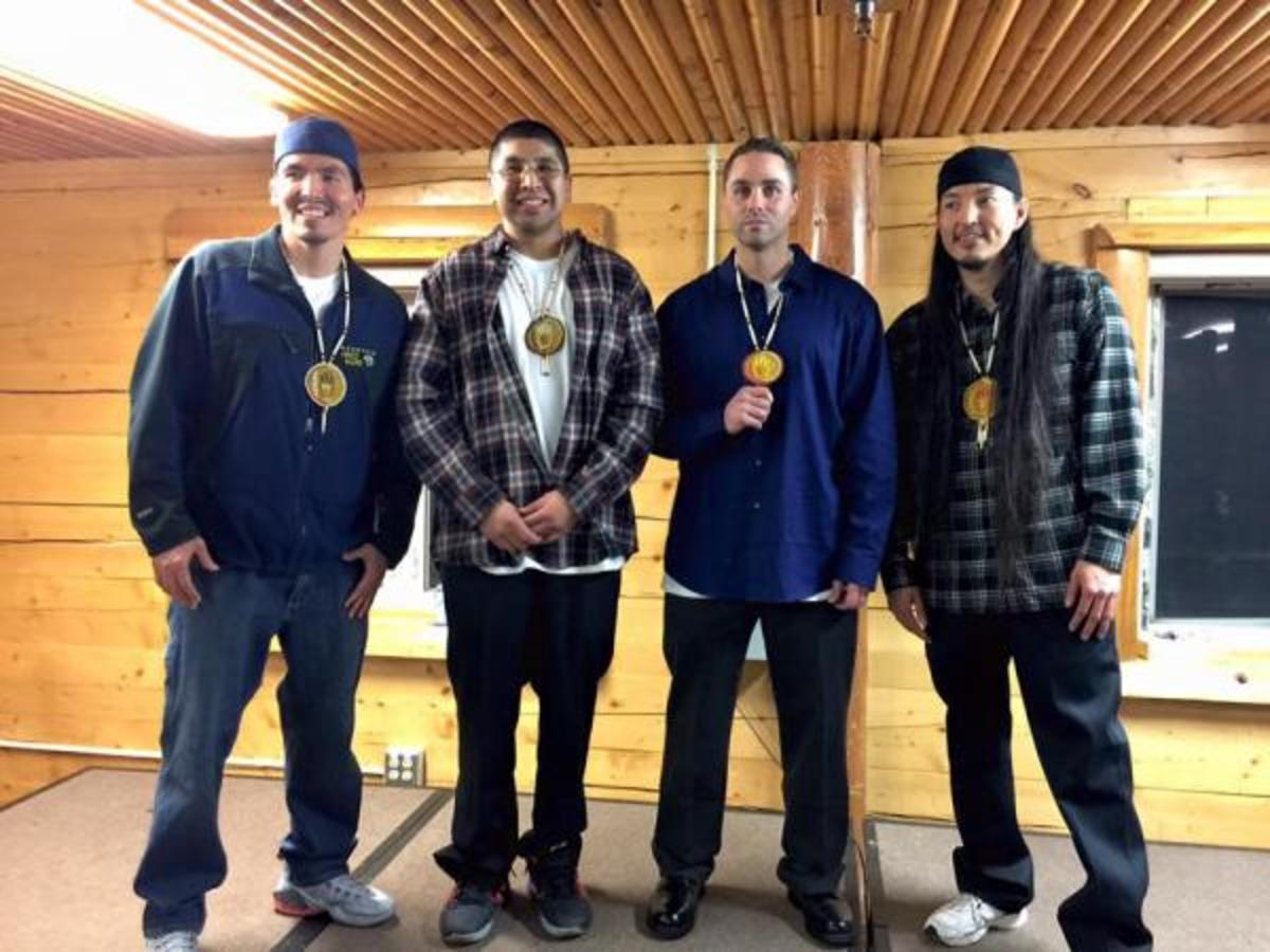 Marvin Roberts, Eugene Vent, Kevin Pease and George Frese, also known as The Fairbanks Four, celebrate their first day together as free men, Dec. 17, at the Chief David Salmon Tribal Hall in Fairbanks.
