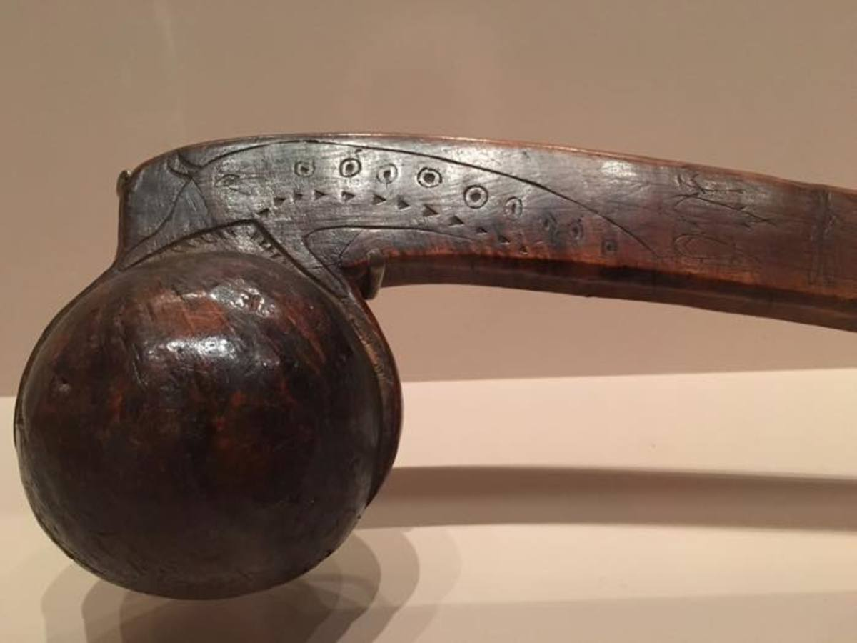 This war club is one of the few items exhibited from the 1700s that shows an example of Native American tattoos. The designs on this were likely to have been on its owners body as well.