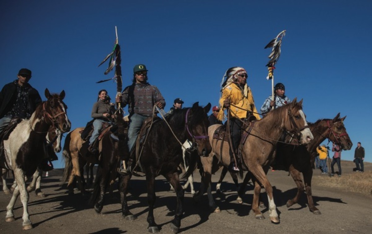 Keeper of the White Buffalo Calf Pipe Arvol Looking Horse and 40 riders bring the Horse Nation into the main camp at Standing Rock to light the sacred fire.