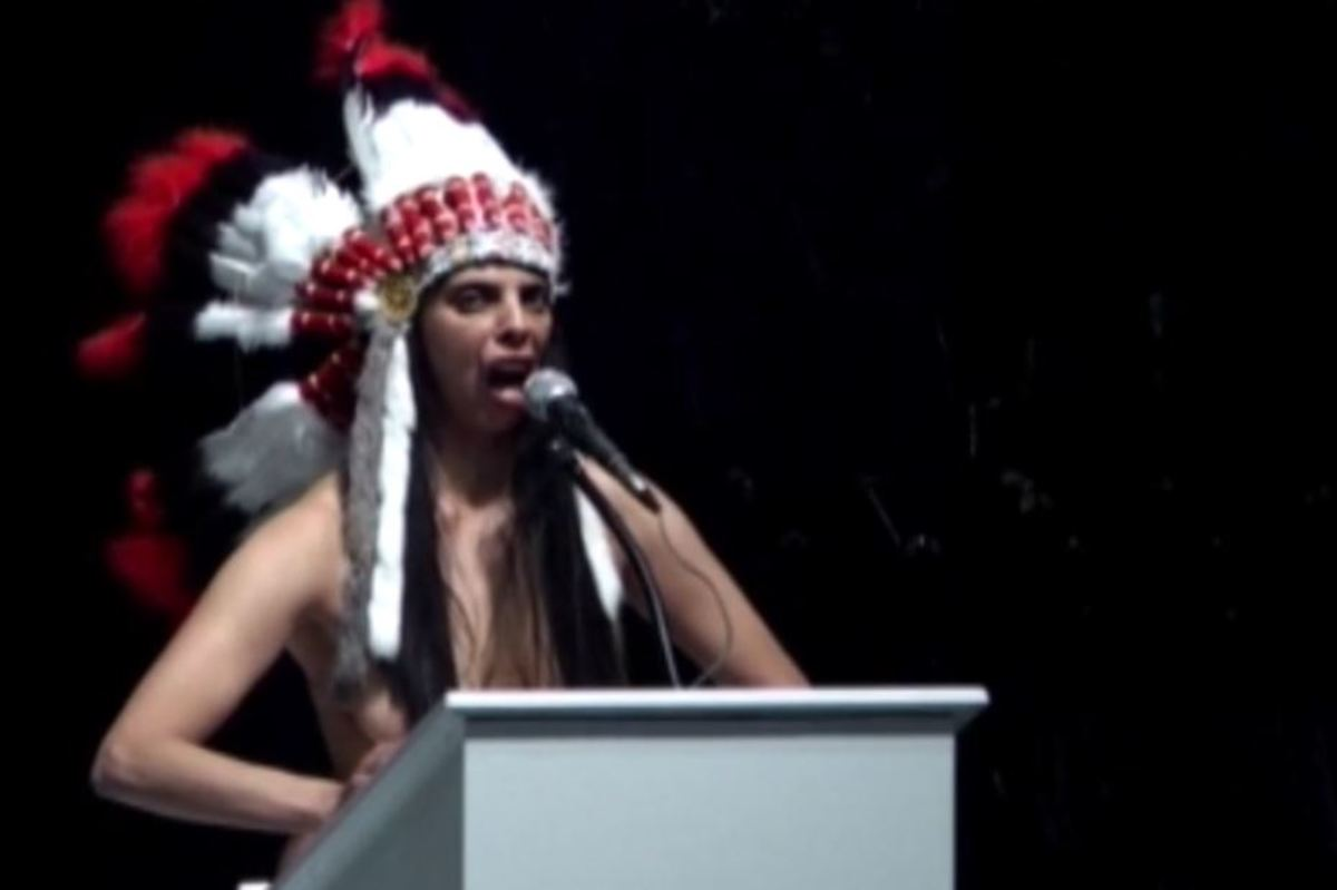 Nude French artist Latifa Laâbissi performed in a faux headdress - Screen capture
