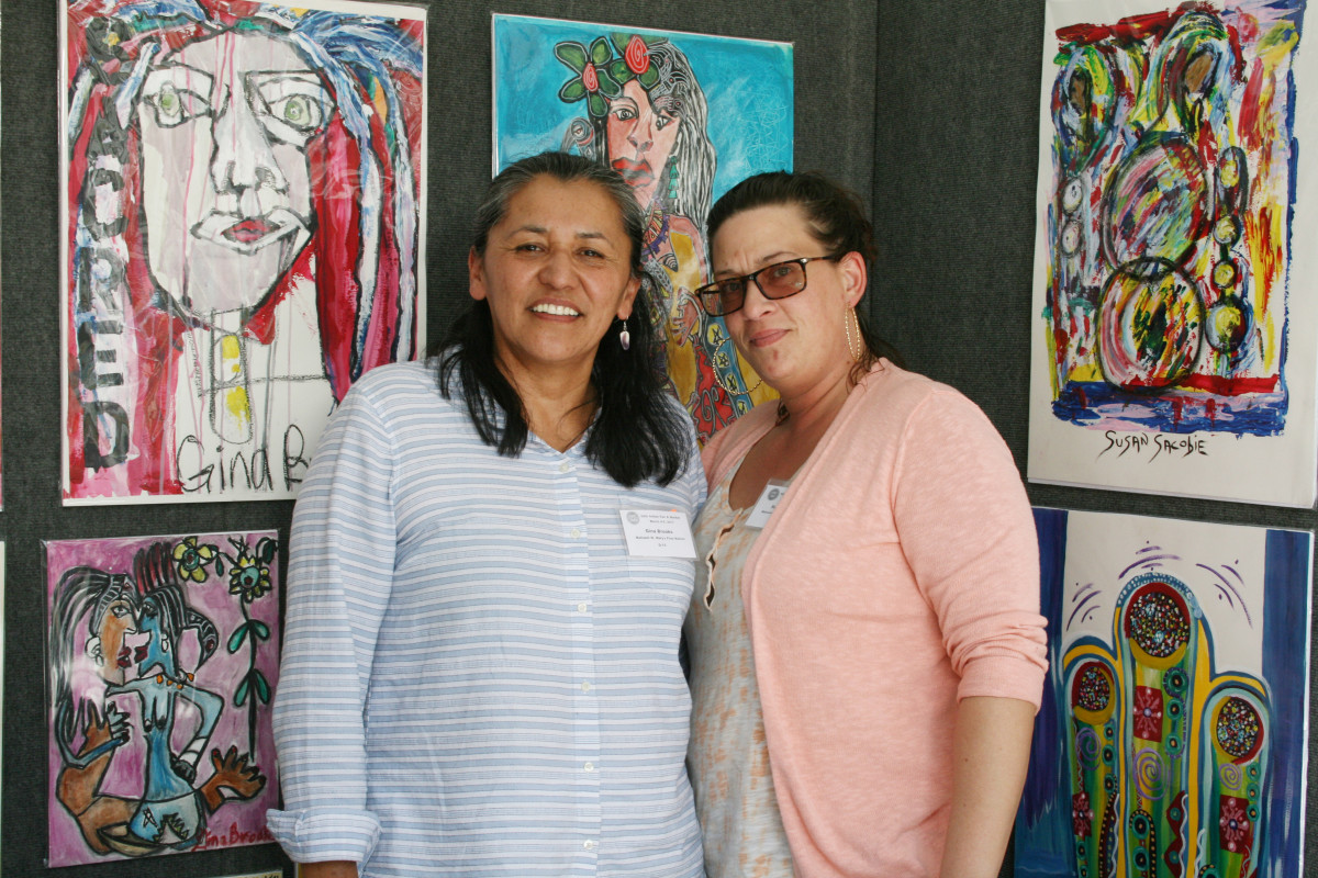 Gail Brooks and Susan Sacobie amidst their beautiful work at the Heard Indian Market.