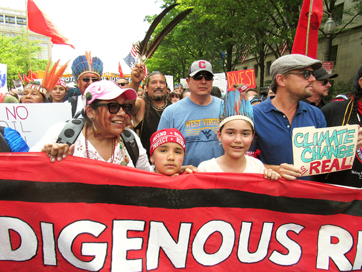 Standing Rock Sioux Chairman David Archambault II, center, was nearly incognito in a light blue t-shirt as he walked with youth and Leonardo DiCaprio in the People's Climate March in Washington, DC on April 29.