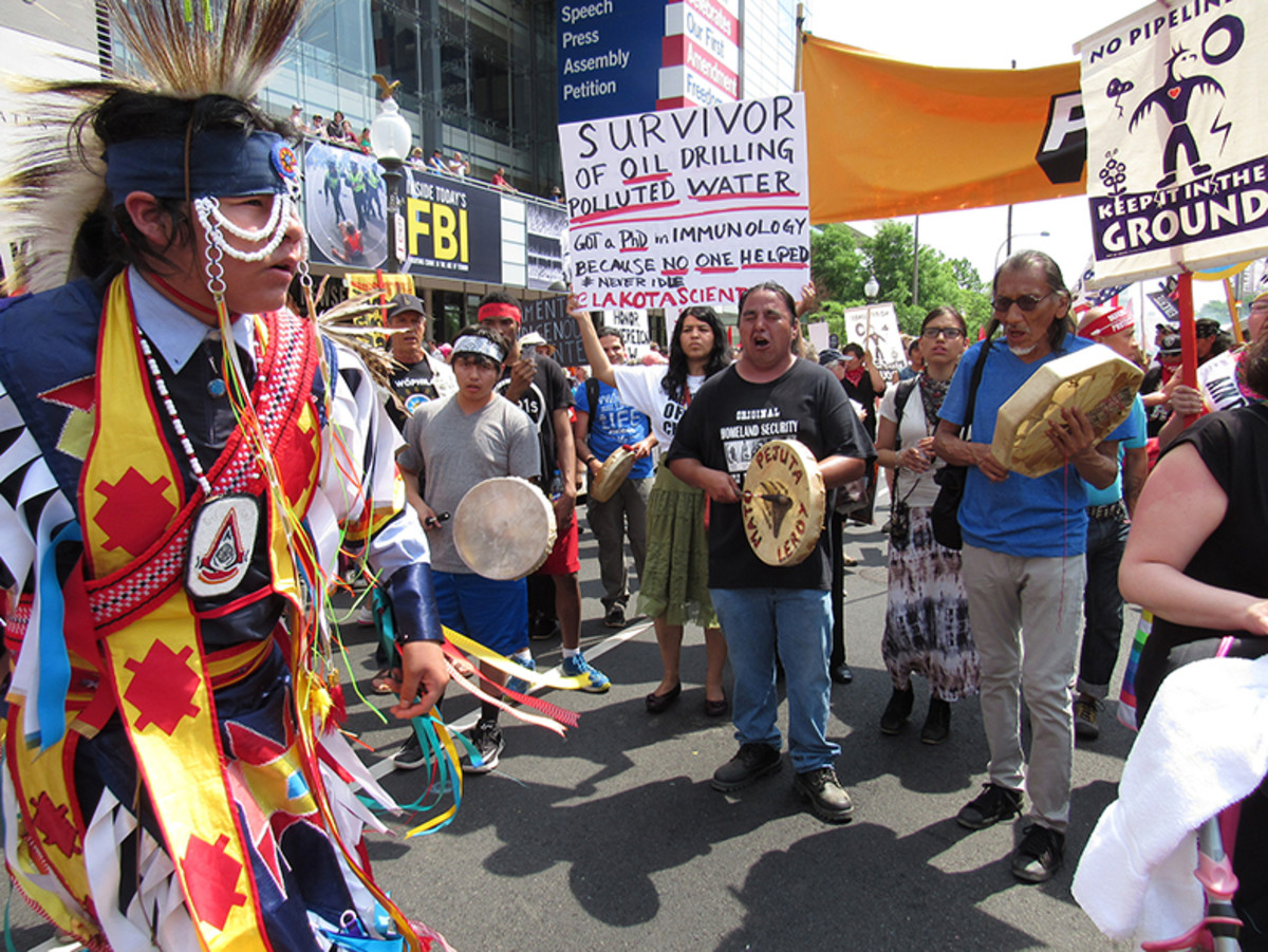 Dozens of drummers singing traditional songs during People's Climate March in Washington DC, led by Indigenous Peoples.