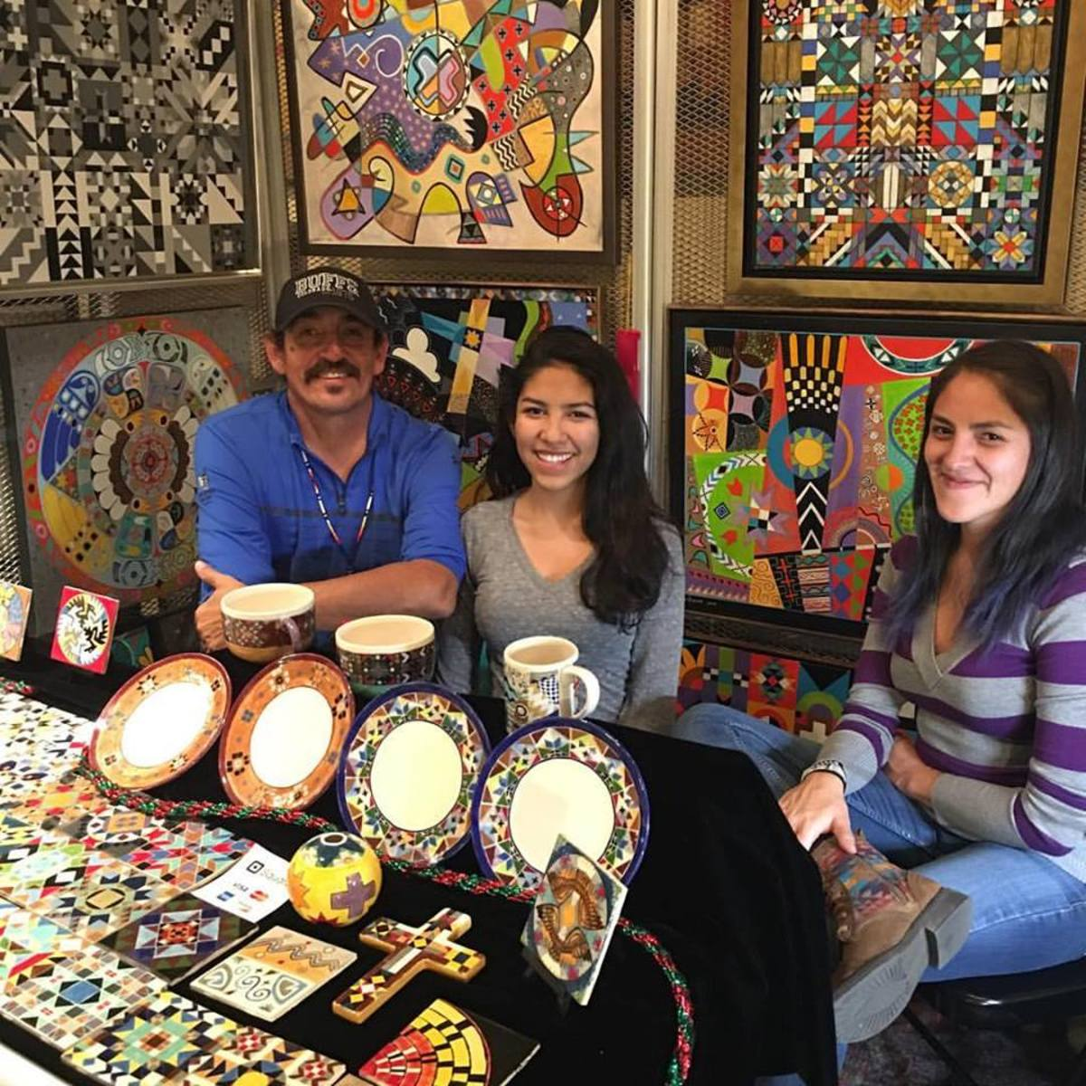 Carson Vicenti, Jicarilla Apache, is seen here with his family at the 2016 SWAIA Santa Fe Indian Market, one of the events mentioned in Santa Fe's cultural map.