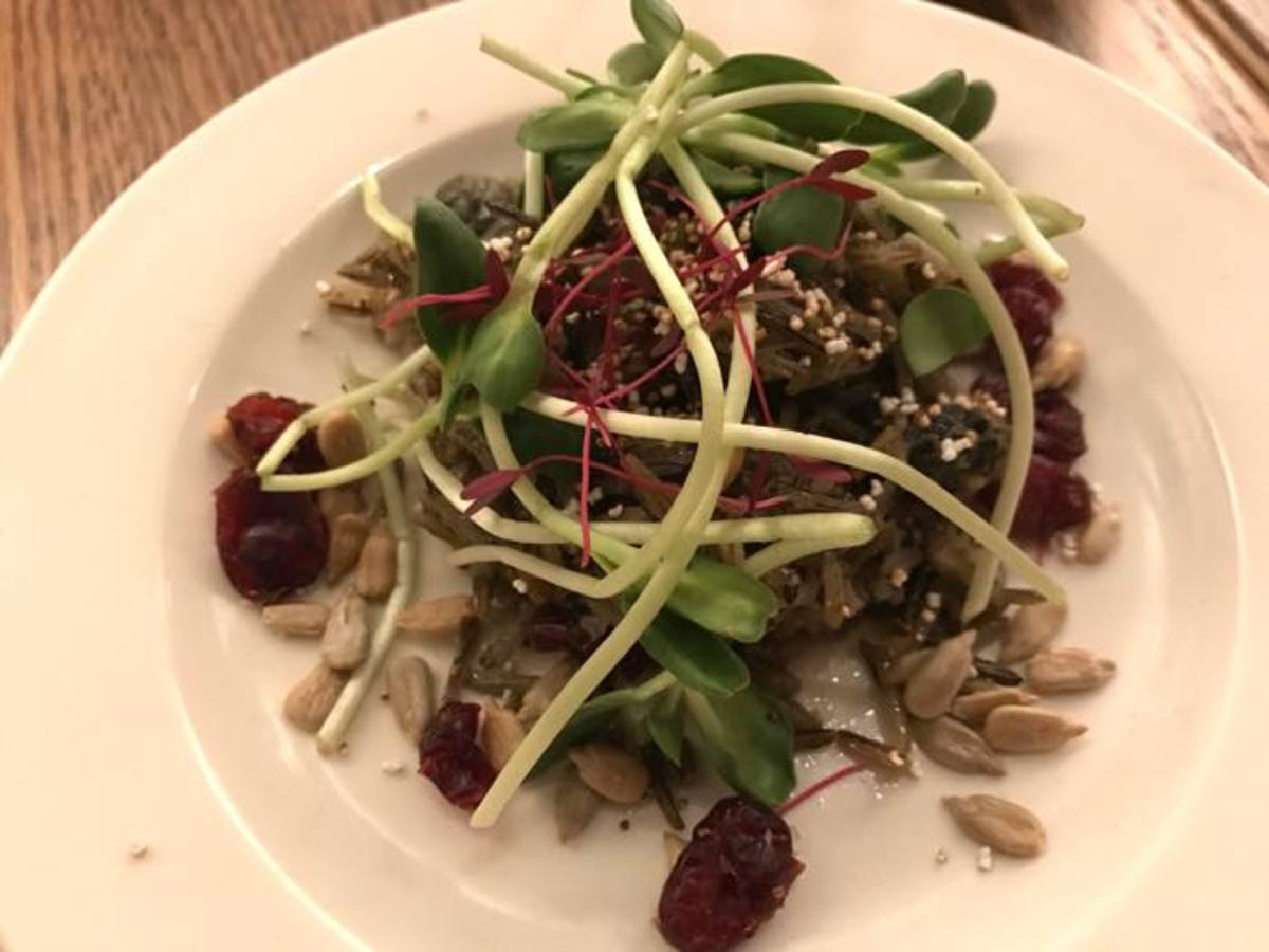 A delicious wild rice and cholla bud salad, topped with sunflower sprouts and dried cranberries, prepared for the Food Sovereignty Symposium's Indigenous Culinary Arts Pop-up Dinner.