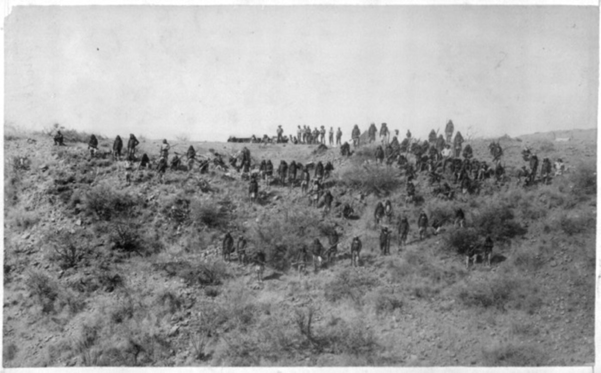 Armed Apaches on hillside, March 25th-26th, 1886. Photo by C. S. Fly, taken before the surrender to Gen. Crook, March 27, 1886, in the Sierra Madre mountains of Mexico. Fly's photographs are the only known images of Indian combatants still in the field who had not yet surrendered to the United States.