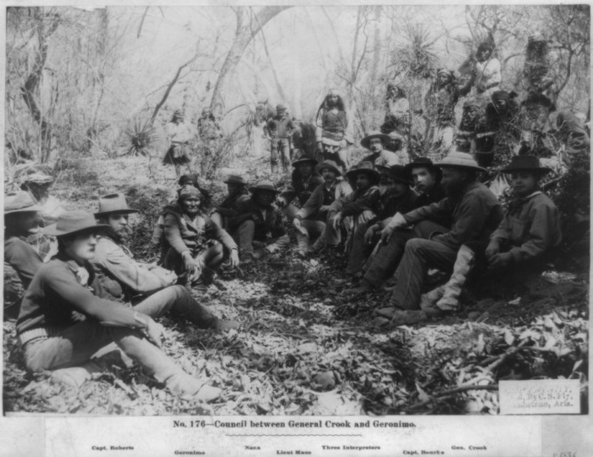 March 27th, 1886: General George Crook, third from right, holds council with Apache leader Geronimo, centre left for a three day conference at Canyon de los Embudos, Sierra Madre. Crook tries unsuccessfully to persuade Geronimo to resign himself to life on a reservation, but the chief escapes on March 30th and continues his raids.