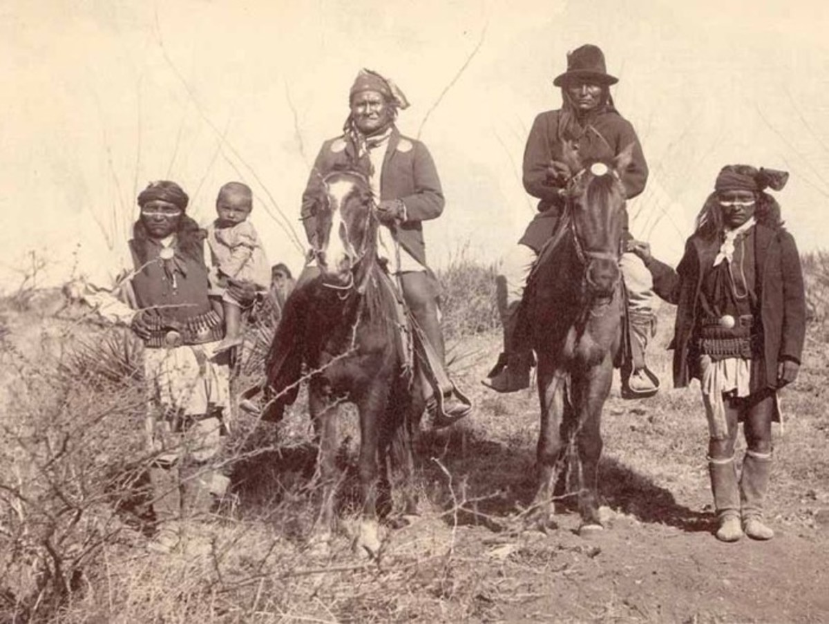 Scene in Geronimo's camp before surrender to General Crook, March 27, 1886: Geronimo & Natches (son of Cochise), mounted, Geronimo's son (Perico) holding baby. Geronimo asked photographer C.S. Fly to take a photo of him and his sons. Fly's photographs are the only known images of Indian combatants still in the field who had not yet surrendered to the United States.