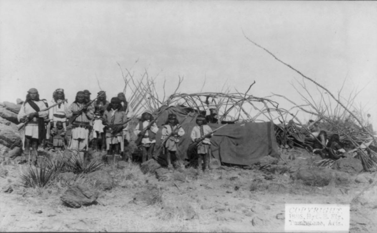 Scene in Geronimo's camp, March 25th-26th, before surrender to General Crook on March 27, 1886, boys with rifles. Photo by C.S. Fly. Fly's photographs are the only known images of Indian combatants still in the field who had not yet surrendered to the United States.