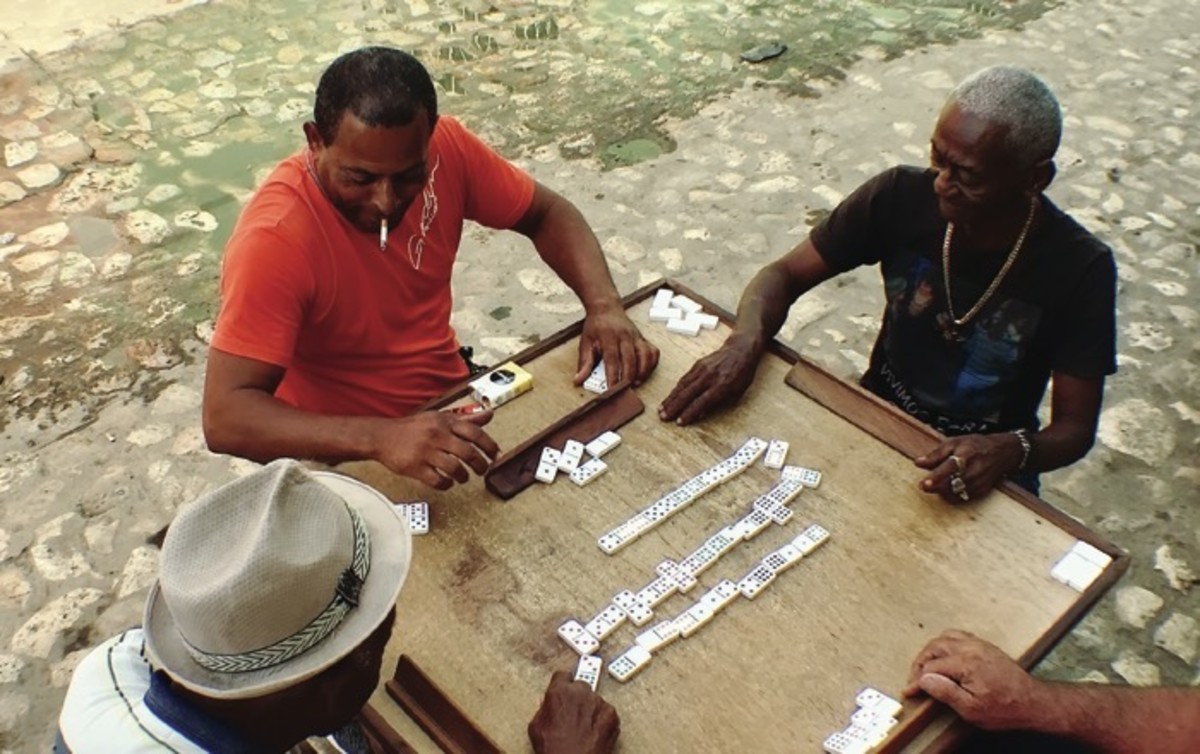 ICMN Issue #2 Master_singlepage_REPAGINATED_Page_059_Image_0001_men play dominoes Trinidad_Winging It In Cuba_th