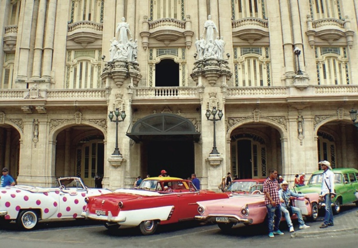 ICMN Issue #2 Master_singlepage_REPAGINATED_Page_054__Image_0001_antique cars Havana's Parque Central historic district_Winging It In Cuba_Jenni Monet_th