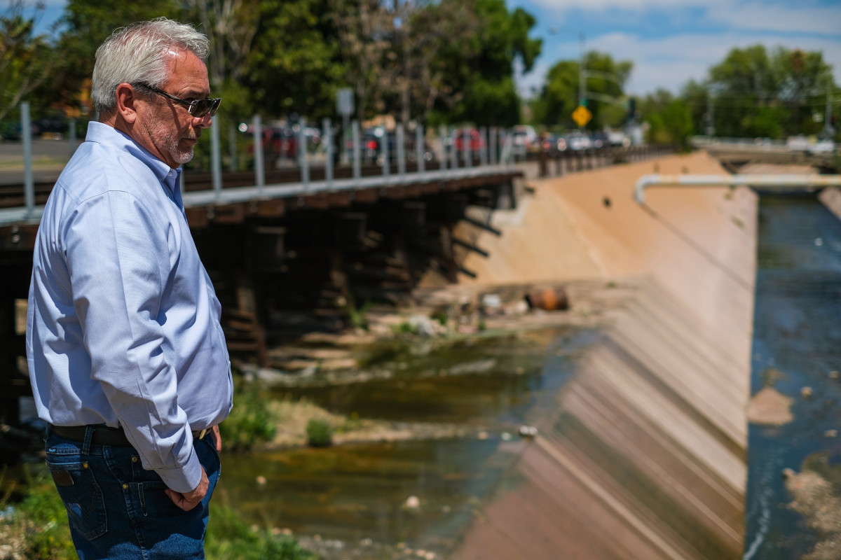 """John Kissinger, deputy city manager of Nogales Arizona, looks at the Nogales Wash at Morely Avenue, the first place on the U.S. side of the border where the wash is visible. """"It's not a good situation,"""" Kissinger says. """"It should be addressed and cleaned up."""" (Photo by Chloe Jones/Cronkite News)"""