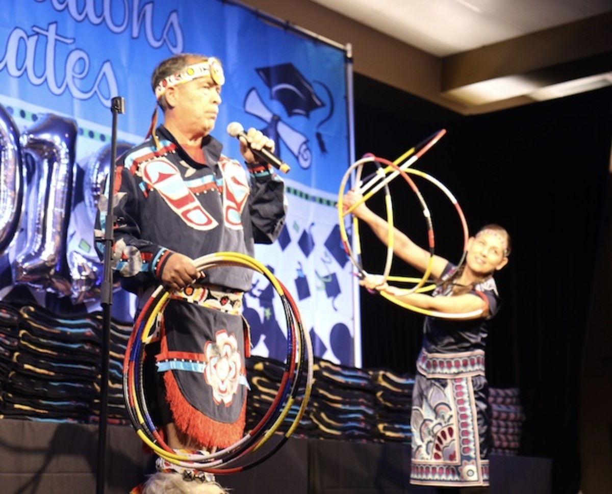 Seven-time World Hoop Dance Champion Terry Goedel performs with daughter Tara Kingi.