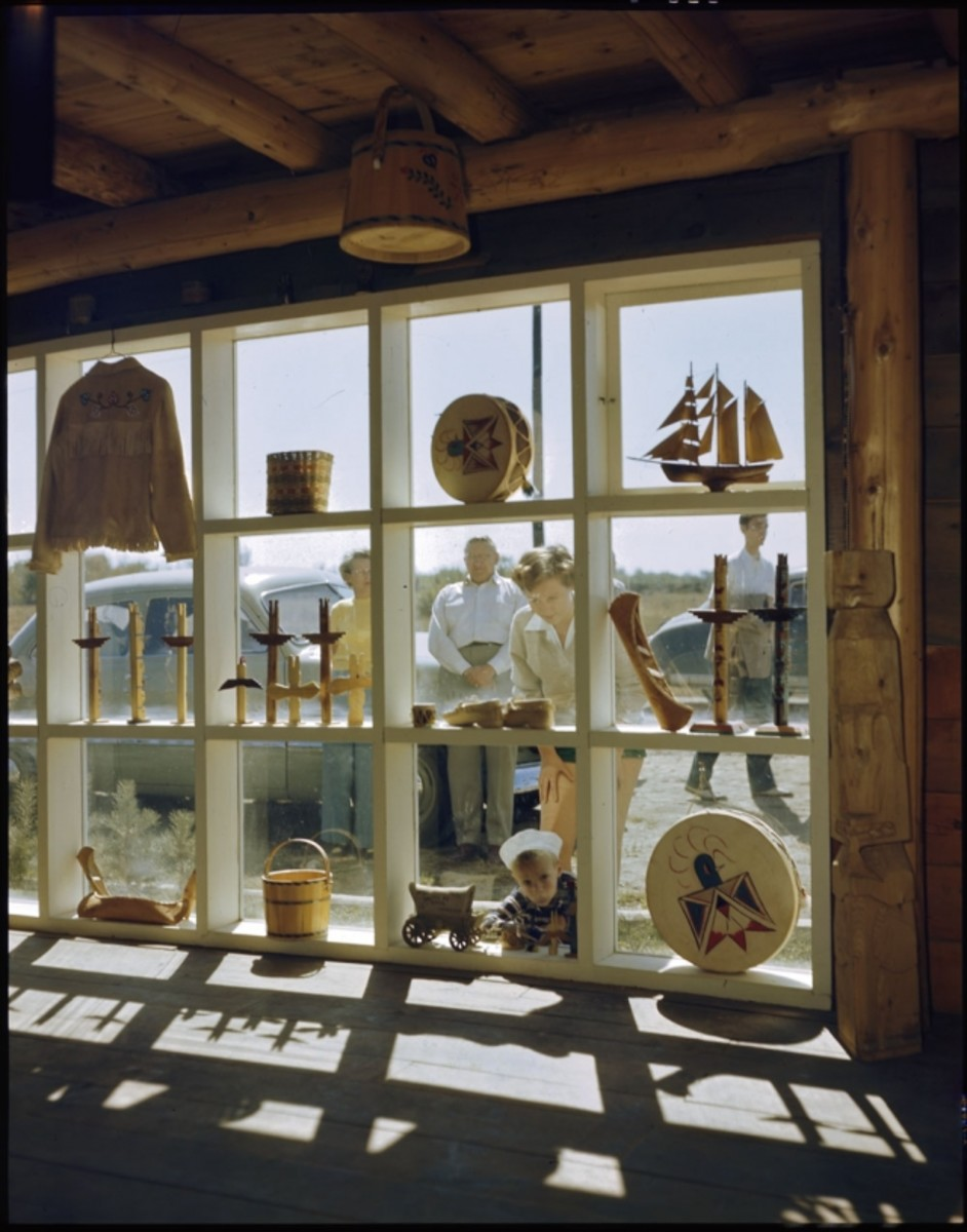 """A family peers through the window of the """"Indian gift shop"""" at Manitowaning Lodge, Manitoulin Island, Ontario in 1949."""