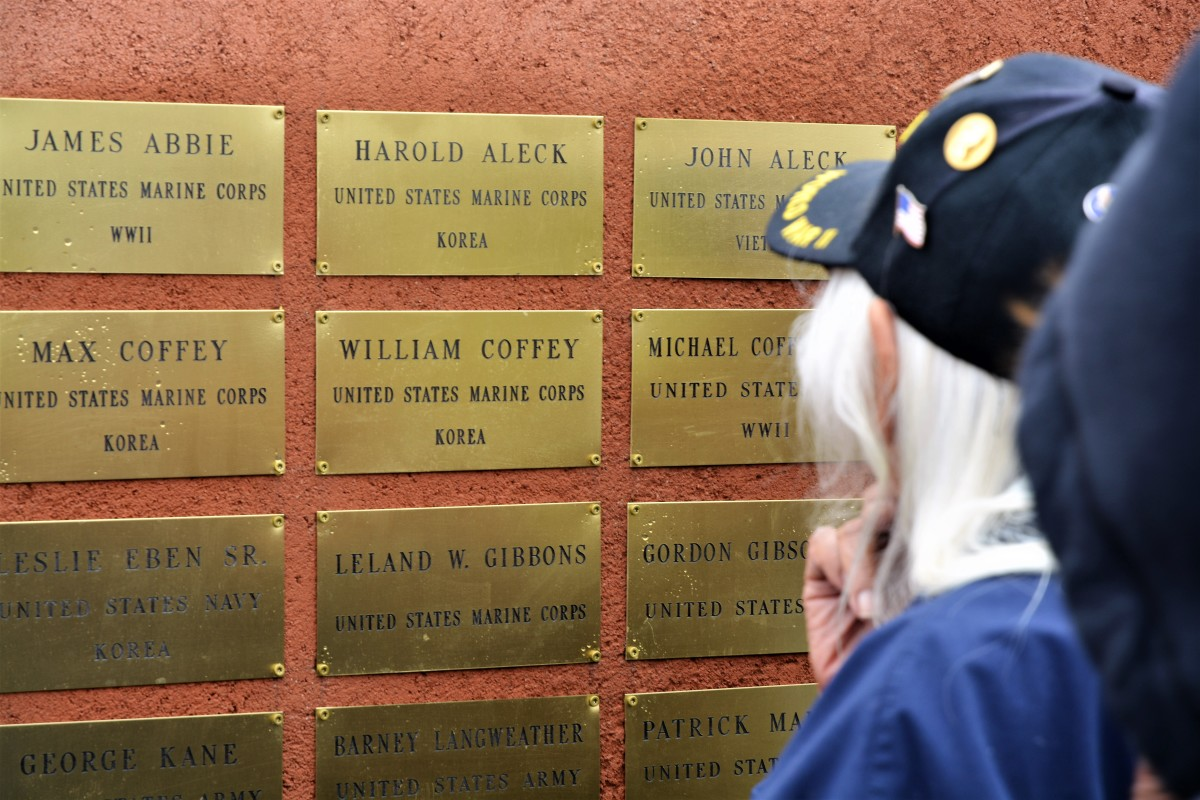 Pictured: Reno-Sparks Indian Colony Veteran Beatrice Thayer looks at a plaque commemorating her family's military experience. Thayer is a WWII and Korean War Veteran, while her relatives, Max, William and Michael Coffey all served, too.