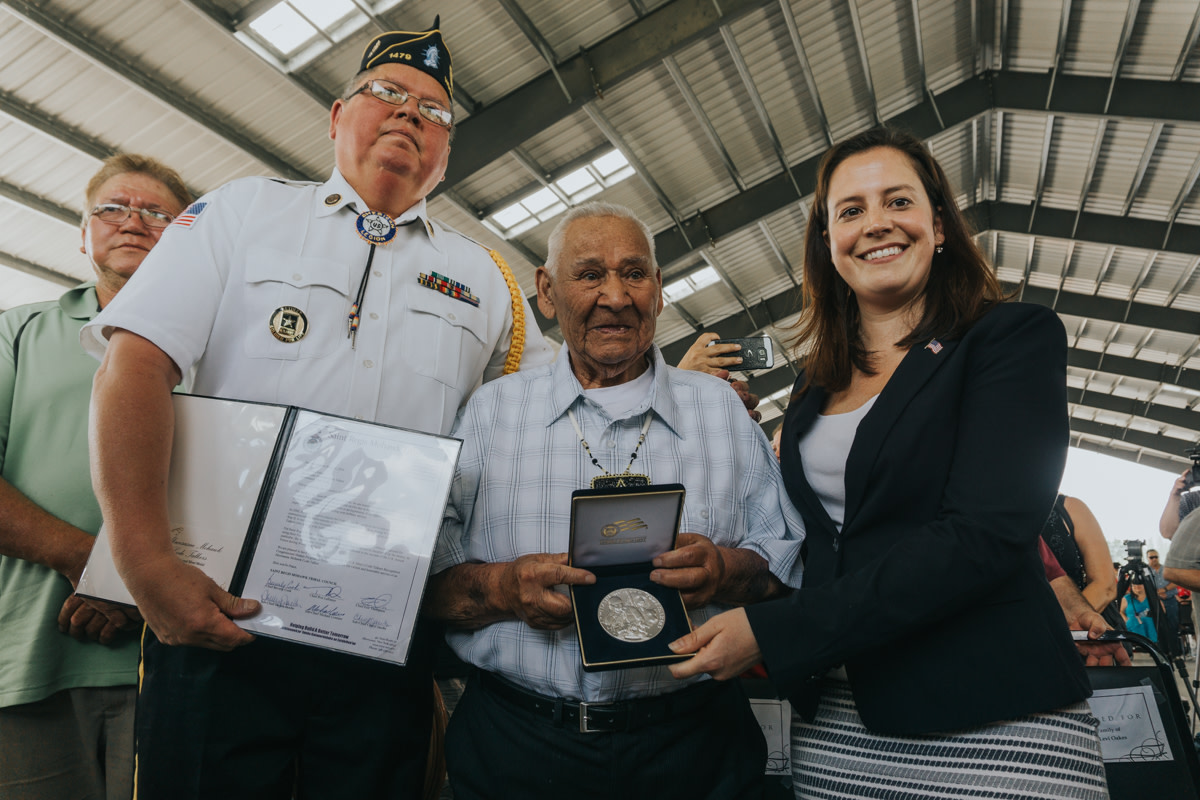 """Akwesasne Mohawk Code Talker Louis Levi Oakes receiving the Congressional Silver Medal from U.S. Congresswoman Elise Stefanick (NY-21) and American Legion Post #1479 Commander Michael """"Goon"""" Cook on Onerahtohkó:wa/May 28, 2016. (Courtesy Saint Regis Mohawk Tribe)"""