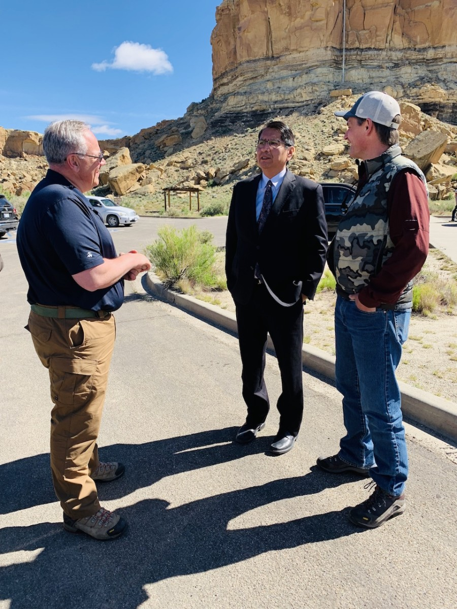 Pictured: Navajo Nation President Jonathan Nez  (middle) speaks with U.S. Secretary of the Interior David Bernhardt and U.S. Senator Martin Heinrich (D-New Mexico) at the Chaco Culture National Historical Park on May 28, 2019.