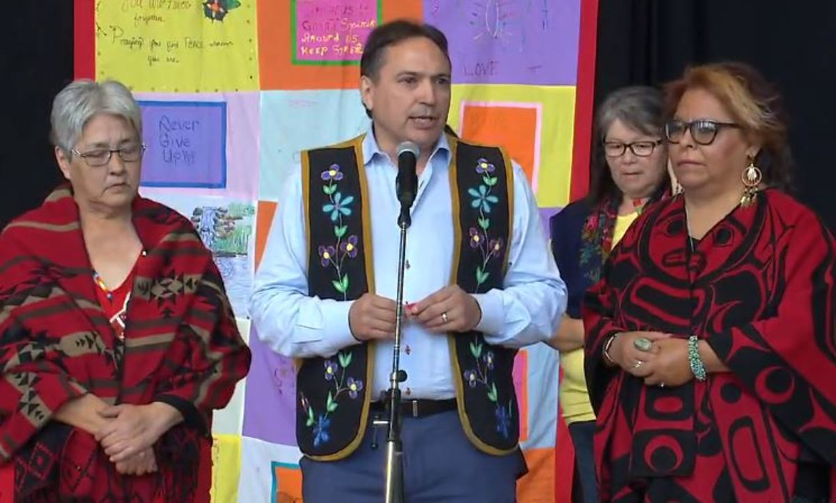 Pictured: Perry Bellegarde with family members of Tina Fontaine Monday at the ceremonial handover of the final report from the National Inquiry into Missing and Murdered Indigenous Women and Girls on June 3, 2019.