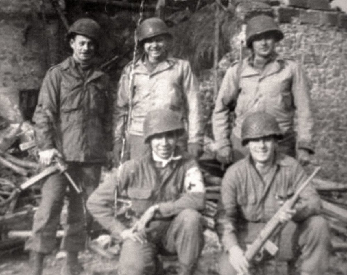 Charles Norman Shay, Penobscot, was a 19-year-old combat medic in WWII. He is in the center, posing with other soldiers - Archive photo