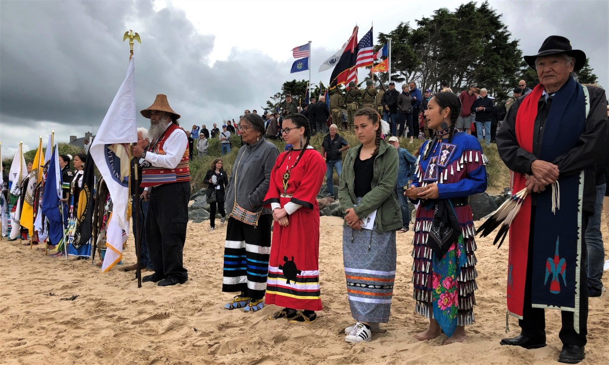 Native people of a multitude of tribes paying respect on Omaha Beach. (Photo Harald E.L. Prins)