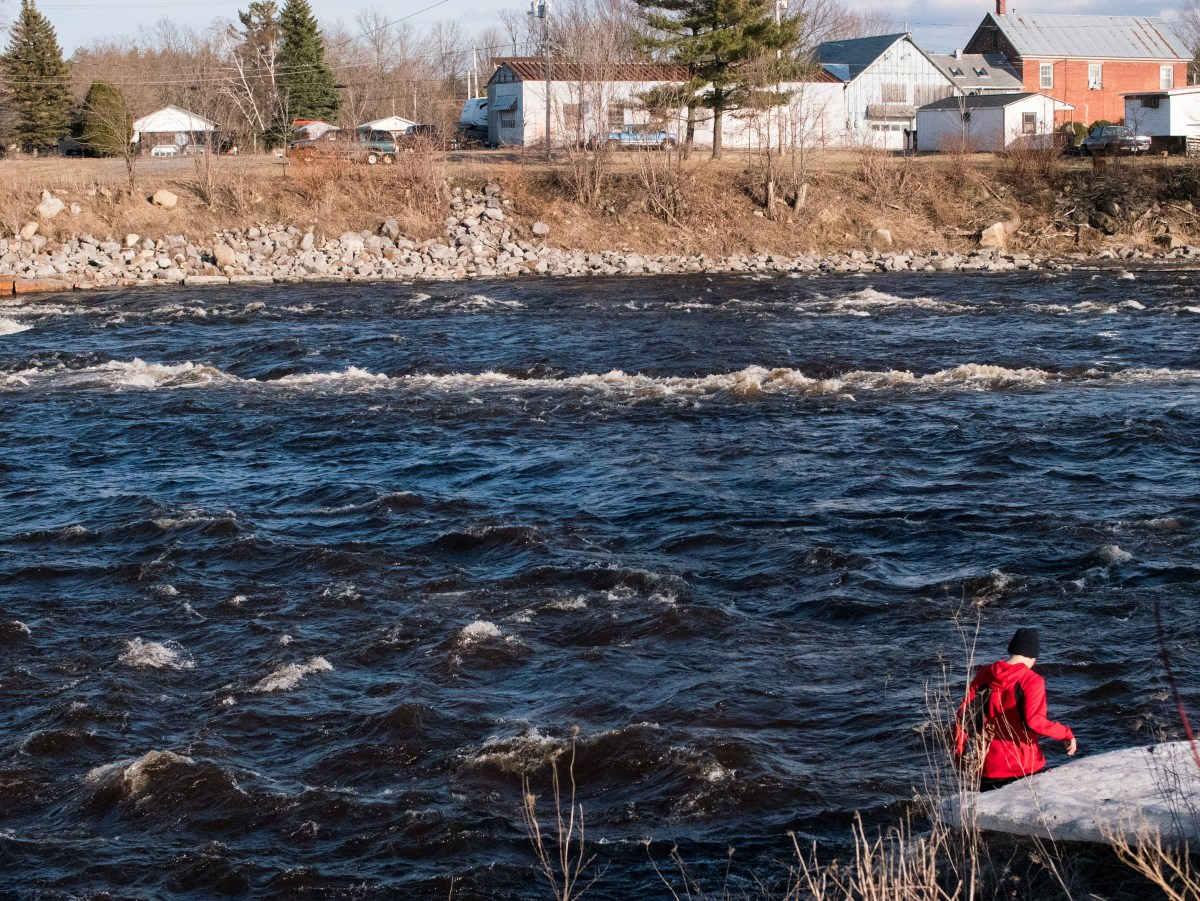 14-year-old Tehokwirathe, walking along the river that runs through the Mohawk nation.